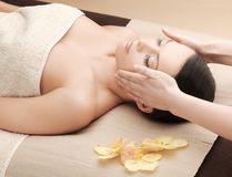 Asian woman in spa. Health and beauty, resort and relaxation concept - asian woman in spa salon getting massage Stock Image
