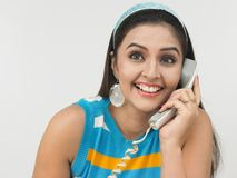 Asian woman speaking in the phone Royalty Free Stock Photo