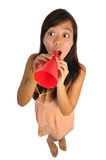 Asian Woman speaking through a red cone Royalty Free Stock Image