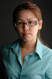 Asian woman in spectacle. With black background royalty free stock photo