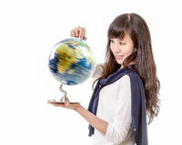 Asian woman with spinning globe in hands Royalty Free Stock Photos