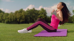 Asian woman in sports wear preparing for fitness workout outdoor stock video footage