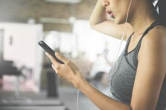 Asian woman in sportswear listening to the music Royalty Free Stock Image