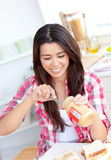 Asian woman spreading peanut butter Stock Photos