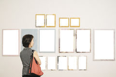 Asian woman standing in an art gallery Royalty Free Stock Photo