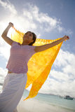 Asian woman standing on the beach. Asian woman with yellow sarong on whithaven beach, Queensland, Australia Royalty Free Stock Photos