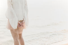 Asian woman standing on the beach Royalty Free Stock Photography