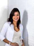 Asian Woman Standing Beside White Shades Stock Photo