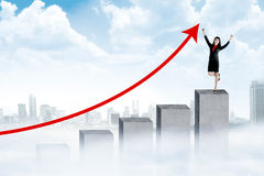Asian woman standing on the chart Stock Images