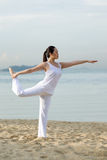 Asian woman standing doing yoga Stock Photos