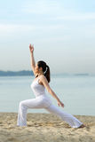 Asian woman standing doing yoga Royalty Free Stock Image