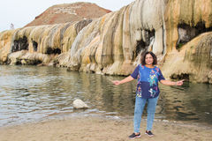 Asian woman standing by hot springs terrace Stock Images