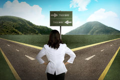 Asian woman standing in the middle of cross road stock photos