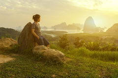 Asian woman standing by the rock look at view of natural in morning. Asian woman standing by the rock look at view of natural mountain and river in morning stock images