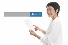 Asian woman standing with white background with search engine gr. Aphic Stock Image