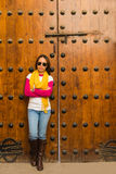 The asian woman stands in front of wooden door in Marakesh Royalty Free Stock Images