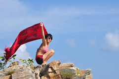 Asian woman on stone Royalty Free Stock Photo