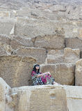 Asian woman on stone steps Royalty Free Stock Image