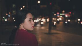 Asian woman on streets at night