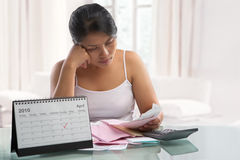 Asian woman stress over bills Royalty Free Stock Photo