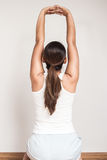 Asian woman stretch oneself Royalty Free Stock Image