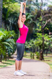 Asian Woman stretching in fitness exercise Stock Image