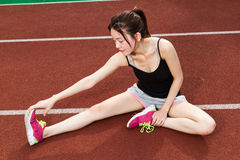 Asian woman stretching on track Stock Photos