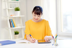 Asian woman student with tablet pc at home Royalty Free Stock Photography