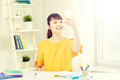 Asian woman student taking selfie with smartphone Stock Photography