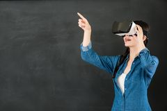 Free Asian Woman Student Touch Screen With VR Headset Royalty Free Stock Image - 87639246