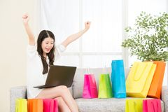 Asian woman successful done online shopping with computer Royalty Free Stock Image