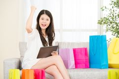 Asian woman successful shopping online with pad Stock Photo