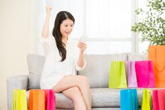 Asian woman successful shopping  online with smartphone Royalty Free Stock Photography