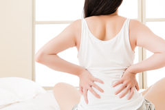 Asian woman suffers back pain backache, spinal lower problem Stock Image