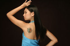 Asian Woman Sun and moon tattoo on shoulder royalty free stock photo