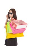 Asian woman with sunglasses  hold shopping bags Stock Images