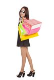 Asian woman with sunglasses  hold shopping bags Stock Photos