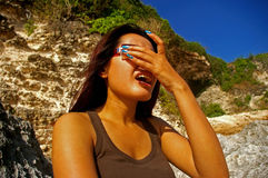 Asian woman in the sunlight Royalty Free Stock Images