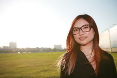 Asian woman with sunset Royalty Free Stock Photos