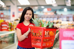 Asian Woman in Supermarket royalty free stock photography