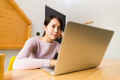 Asian Woman surf internet by laptop computer Stock Images
