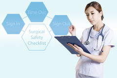 Asian woman surgeon in operation room Stock Photos