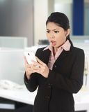 Asian woman surprise looking at her cellphone Royalty Free Stock Photography
