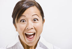 Asian woman with a surprised Look. Asian woman surprised with open mouth. Horizontally framed Royalty Free Stock Photo
