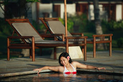 Asian Woman at Swimming Pool Royalty Free Stock Photo