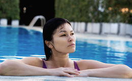 Asian woman at swimming pool. Stock Images