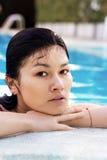 Asian woman at swimming pool. Royalty Free Stock Photos