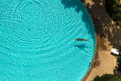 Asian woman swimming  in the pool view from above Royalty Free Stock Photography