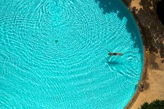 Asian woman swimming  in the pool view from above Stock Photography