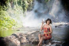 Asian woman take a bath in waterfall ,thailand royalty free stock photo